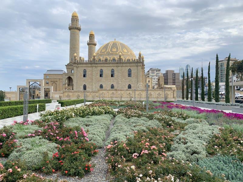 Baku, Azerbaijan, September, 10, 2019. Flower bed in front of the mosque Tezepir in the fall in Baku. Baku, Azerbaijan. Flower bed in front of the mosque Tezepir stock photo