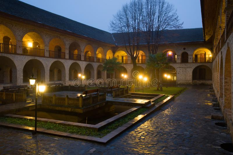 The courtyard of the ancient upper `Caravanserai` in the January twilight. Sheki, Azerbaijan stock photo