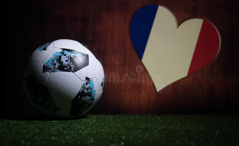BAKU,AZERBAIJAN - JULY 08, 2018 : Creative concept. Official Russia 2018 World Cup football ball The Adidas Telstar 18 on green gr. Ass. Support France team stock photos