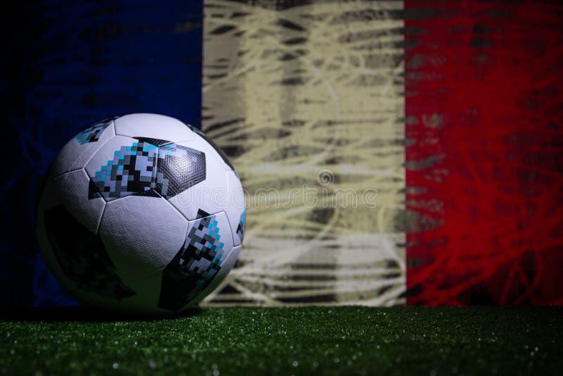 BAKU,AZERBAIJAN - JULY 08, 2018 : Creative concept. Official Russia 2018 World Cup football ball The Adidas Telstar 18 on green gr. Ass. Support France team royalty free stock image