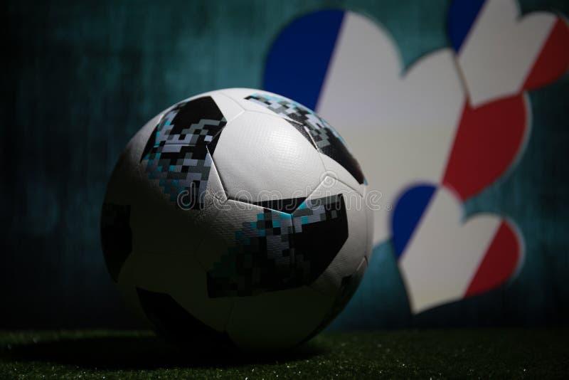 BAKU,AZERBAIJAN - JULY 08, 2018 : Creative concept. Official Russia 2018 World Cup football ball The Adidas Telstar 18 on green gr. Ass. Support France team royalty free stock photography
