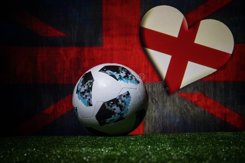BAKU,AZERBAIJAN - JULY 08, 2018 : Creative concept. Official Russia 2018 World Cup football ball The Adidas Telstar 18 on green gr. Ass. Support England team royalty free stock photos