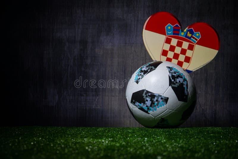 BAKU,AZERBAIJAN - JULY 08, 2018 : Creative concept. Official Russia 2018 World Cup football ball The Adidas Telstar 18 on green gr. Ass. Support Croatia team stock images