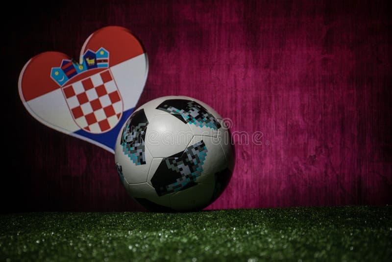 BAKU,AZERBAIJAN - JULY 08, 2018 : Creative concept. Official Russia 2018 World Cup football ball The Adidas Telstar 18 on green gr. Ass. Support Croatia team royalty free stock images