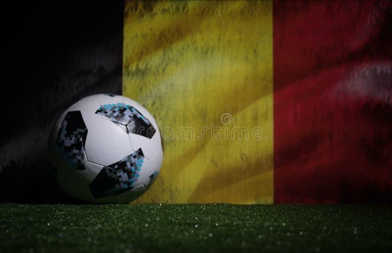 BAKU,AZERBAIJAN - JULY 08, 2018 : Creative concept. Official Russia 2018 World Cup football ball The Adidas Telstar 18 on green gr. Ass. Support Belgium team stock photos