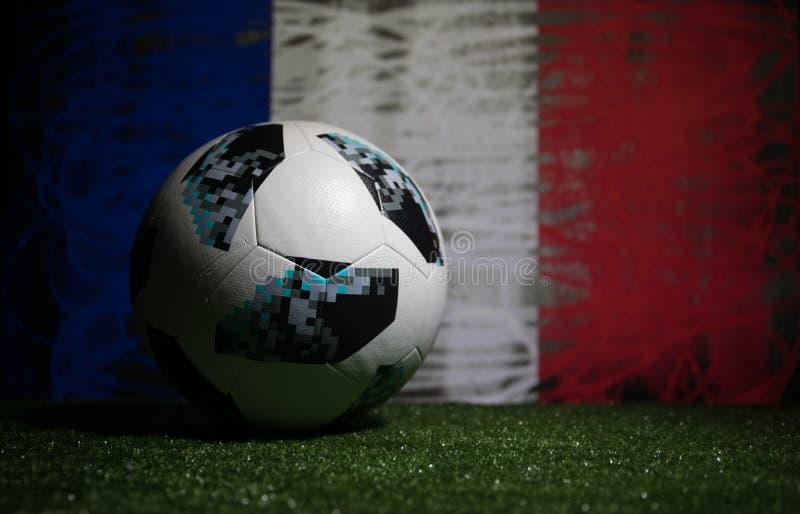 BAKU,AZERBAIJAN - JULY 08, 2018 : Creative concept. Official Russia 2018 World Cup football ball The Adidas Telstar 18 on green gr. Ass. Support France team stock image