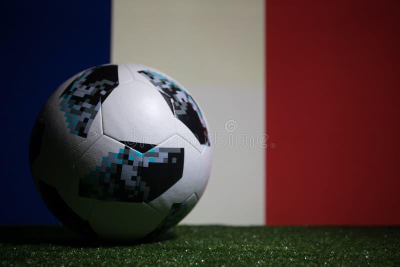 BAKU,AZERBAIJAN - JULY 08, 2018 : Creative concept. Official Russia 2018 World Cup football ball The Adidas Telstar 18 on green gr. Ass. Support France team stock images