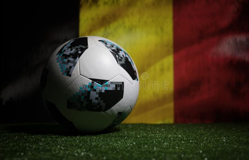 BAKU,AZERBAIJAN - JULY 08, 2018 : Creative concept. Official Russia 2018 World Cup football ball The Adidas Telstar 18 on green gr. Ass. Support Belgium team royalty free stock photos
