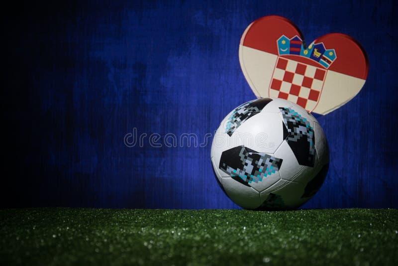 BAKU,AZERBAIJAN - JULY 08, 2018 : Creative concept. Official Russia 2018 World Cup football ball The Adidas Telstar 18 on green gr. Ass. Support Croatia team royalty free stock photography