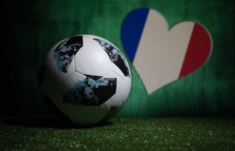 BAKU,AZERBAIJAN - JULY 08, 2018 : Creative concept. Official Russia 2018 World Cup football ball The Adidas Telstar 18 on green gr. Ass. Support France team royalty free stock photos