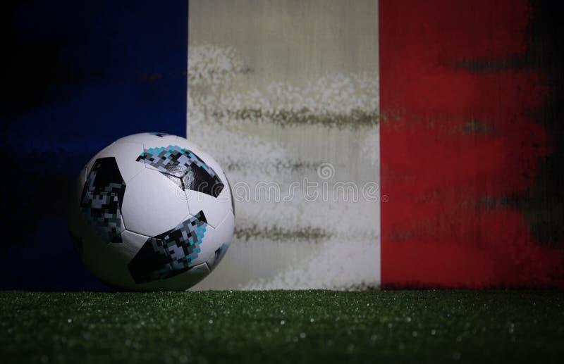 BAKU,AZERBAIJAN - JULY 08, 2018 : Creative concept. Official Russia 2018 World Cup football ball The Adidas Telstar 18 on green gr. Ass. Support France team stock photo