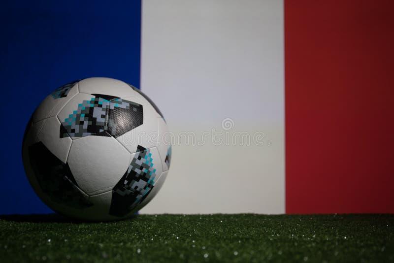 BAKU,AZERBAIJAN - JULY 08, 2018 : Creative concept. Official Russia 2018 World Cup football ball The Adidas Telstar 18 on green gr. Ass. Support France team stock photography