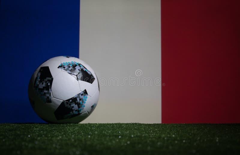 BAKU,AZERBAIJAN - JULY 08, 2018 : Creative concept. Official Russia 2018 World Cup football ball The Adidas Telstar 18 on green gr. Ass. Support France team royalty free stock photo