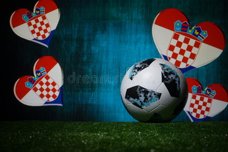 BAKU,AZERBAIJAN - JULY 08, 2018 : Creative concept. Official Russia 2018 World Cup football ball The Adidas Telstar 18 on green gr. Ass. Support Croatia team stock photo