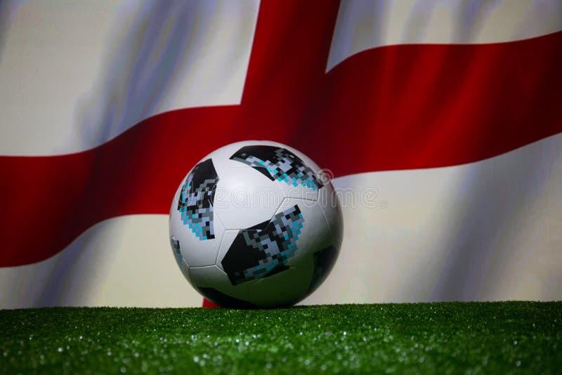 BAKU,AZERBAIJAN - JULY 08, 2018 : Creative concept. Official Russia 2018 World Cup football ball The Adidas Telstar 18 on green gr. Ass. Support England team stock images