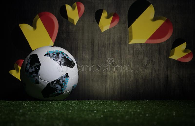 BAKU,AZERBAIJAN - JULY 08, 2018 : Creative concept. Official Russia 2018 World Cup football ball The Adidas Telstar 18 on green gr. Ass. Support Belgium team royalty free stock photography