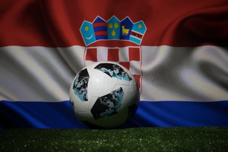BAKU,AZERBAIJAN - JULY 08, 2018 : Creative concept. Official Russia 2018 World Cup football ball The Adidas Telstar 18 on green gr. Ass. Support Croatia team stock image