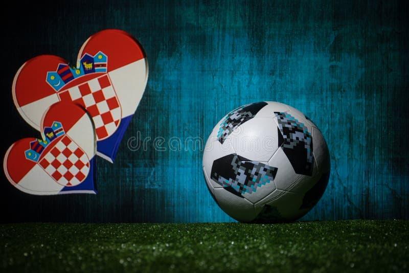 BAKU,AZERBAIJAN - JULY 08, 2018 : Creative concept. Official Russia 2018 World Cup football ball The Adidas Telstar 18 on green gr. Ass. Support Croatia team royalty free stock photos