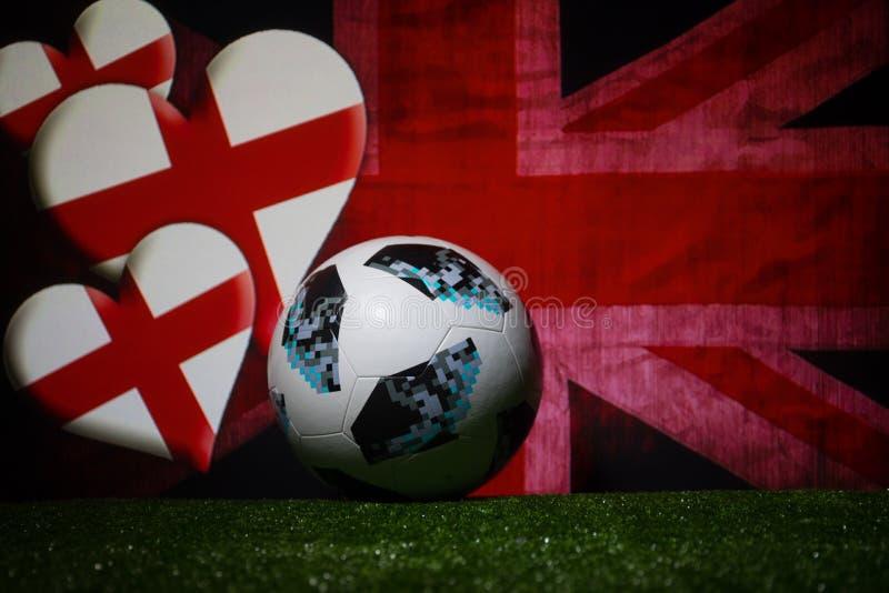 BAKU,AZERBAIJAN - JULY 08, 2018 : Creative concept. Official Russia 2018 World Cup football ball The Adidas Telstar 18 on green gr. Ass. Support England team stock photo