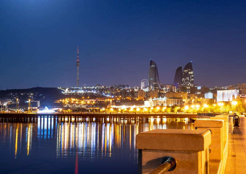 Baku Azerbaijan - 16 June, 2019. Reflection of the lights of the night city in the caspian sea. Night view of Baku with the Flame royalty free stock photography