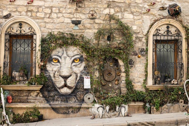 Baku azerbaijan old city. street art wall plant tree decoration. tiger face picture. Beautiful unusual decoration stock image