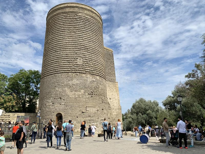 Baku, Azerbaijan, September, 09, 2019. People walking near Maiden Tower in Old city, Icheri Sheher is the historical core of Baku. Baku, Azerbaijan. People royalty free stock photos