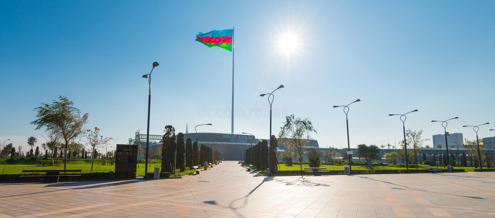 Baku bay embankment, National flag place. Sun and flag stock photos