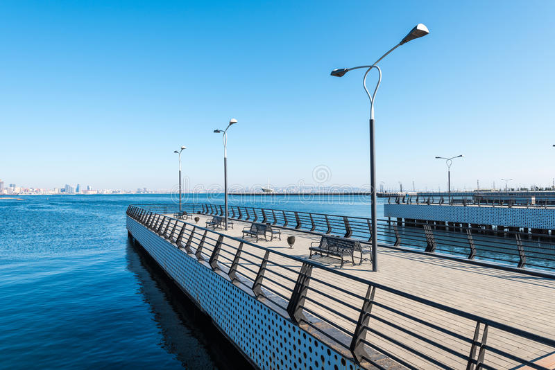 Baku bay embankment. Pier on sea. Baku city, Azerbaijan. National seaside park royalty free stock photo