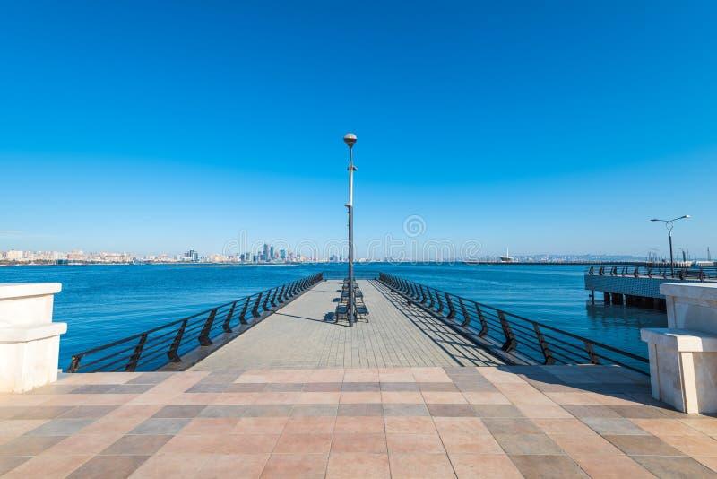 Baku bay embankment. Pier on sea. Baku city, Azerbaijan. National seaside park stock image