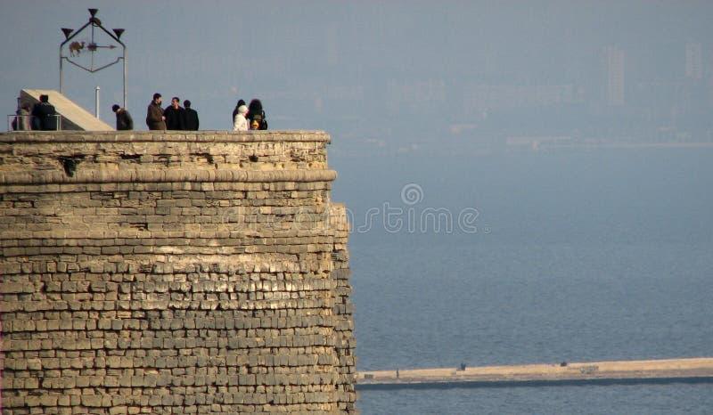 The Old Maiden Tower of Baku, Azerbaijan over the Caspian Sea royalty free stock photo