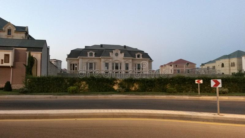 Baku city luxury villas area daylight residence photo. From the road stock image