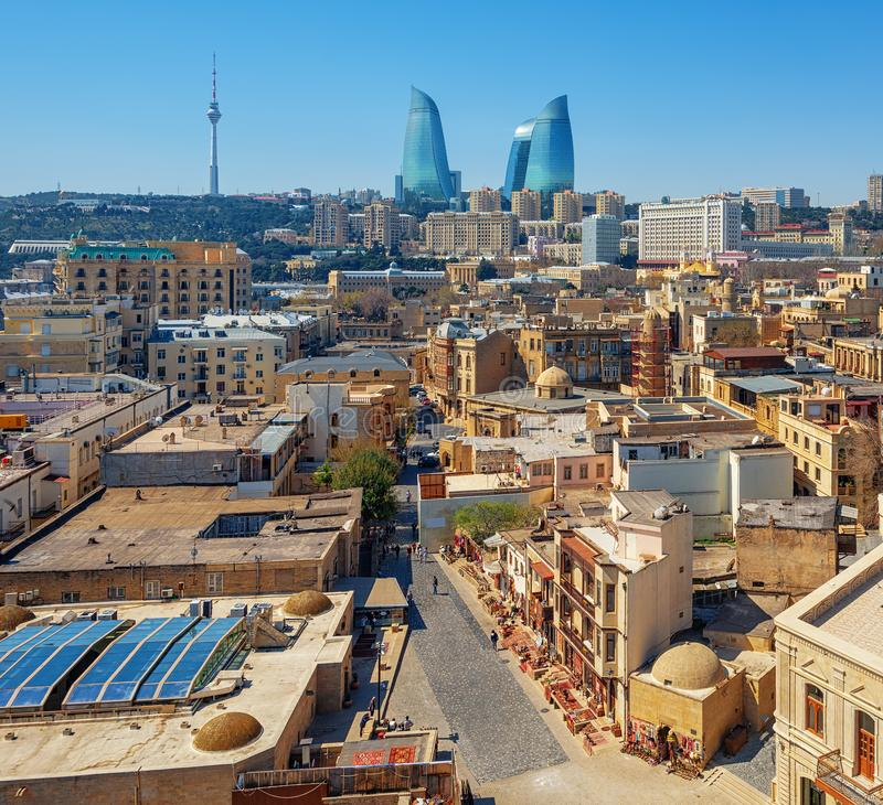 Baku city, the Old town and modern skyline, Azerbaijan. Baku city, aerial view over the Old town and modern skyline with iconic Flame Towers building, Azerbaijan stock photography