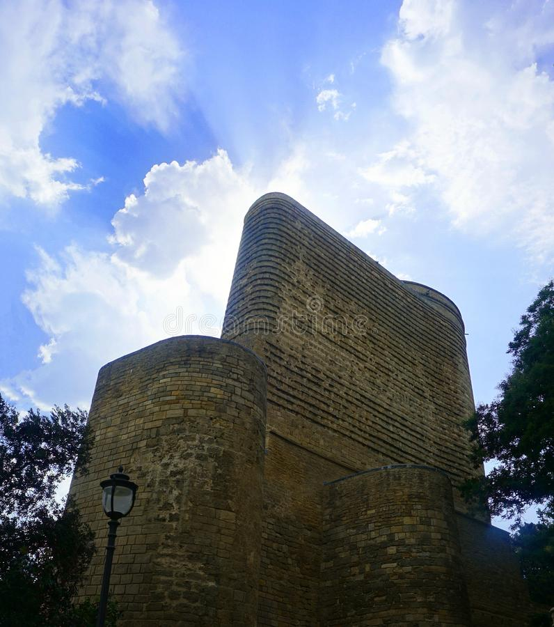 Baku Maiden Tower Back View. At Noon Time with awesome Cloudy Blue Sky Background royalty free stock photo