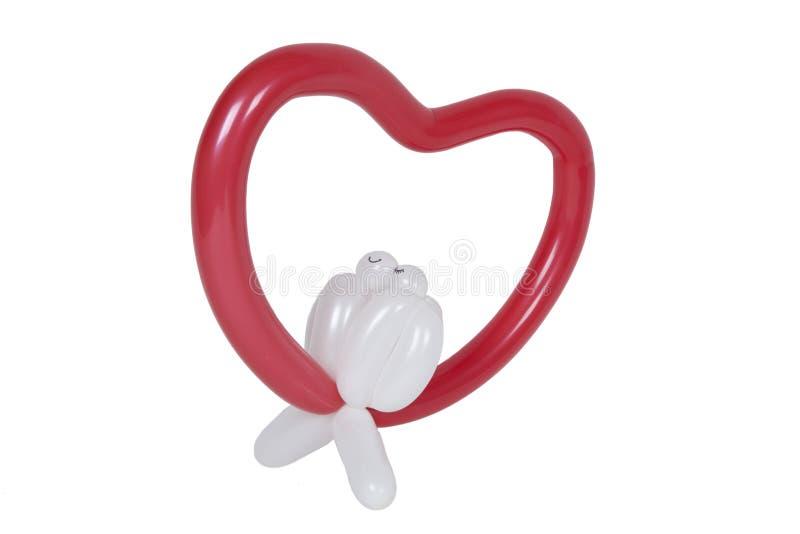 Balão dado forma como o cervo com pássaros do amor fotografia de stock
