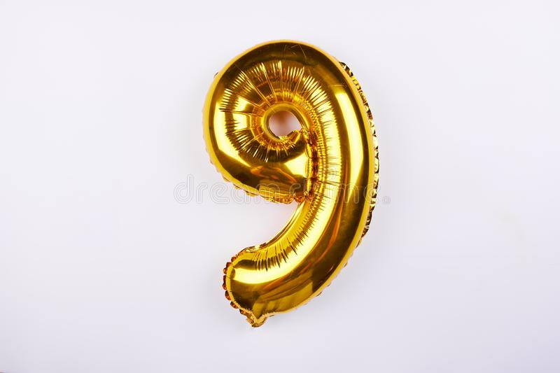 Balão dourado do número 9 fotografia de stock royalty free
