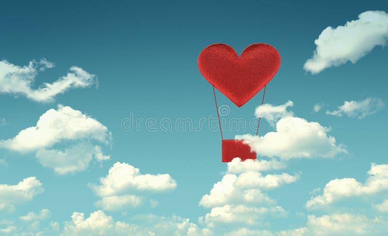 Balón de aire rojo del corazón de la tela en fondo del cielo azul fotografía de archivo