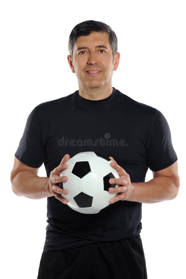Balón de fútbol de la explotación agrícola del hombre imágenes de archivo libres de regalías