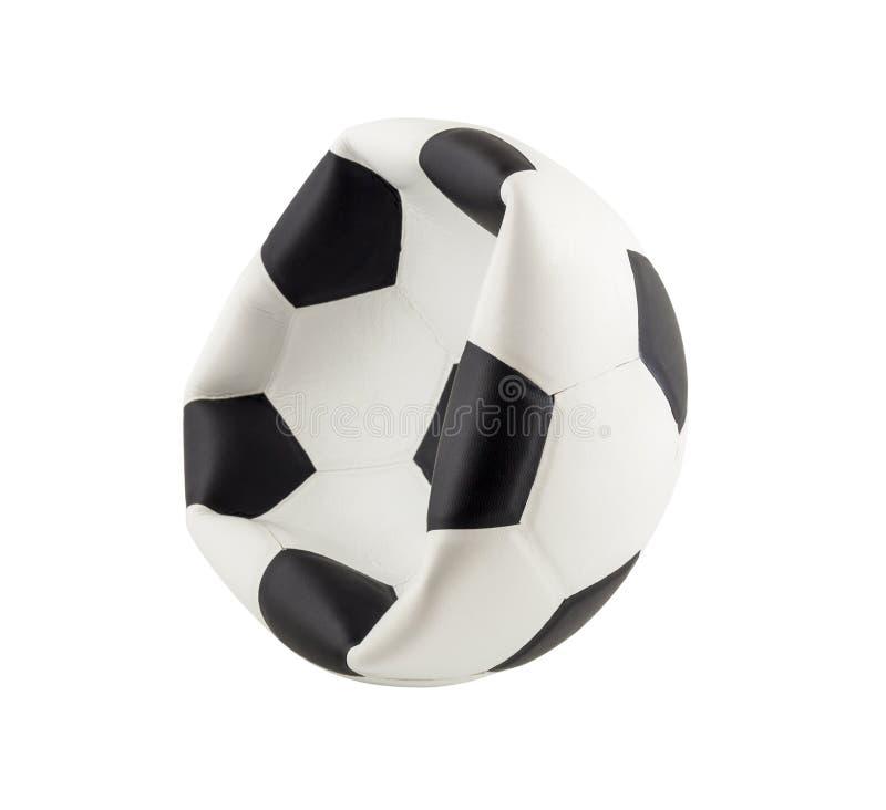 Balón de fútbol desinflado aislado en el fondo blanco imágenes de archivo libres de regalías
