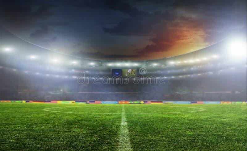 Balón de fútbol en el campo del estadio foto de archivo libre de regalías