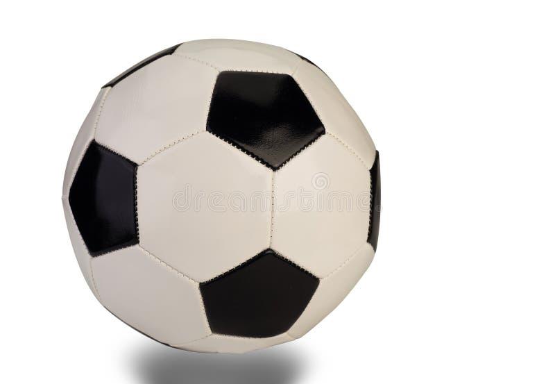 Balón de fútbol en el fondo blanco imagenes de archivo
