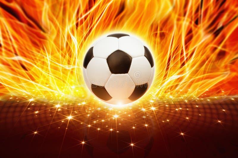 Balón de fútbol en fuego imagenes de archivo