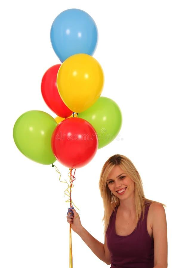 Balões bonitos da terra arrendada da mulher imagem de stock royalty free