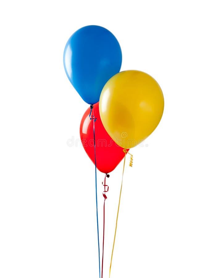Balões coloridos em um fundo branco fotos de stock royalty free