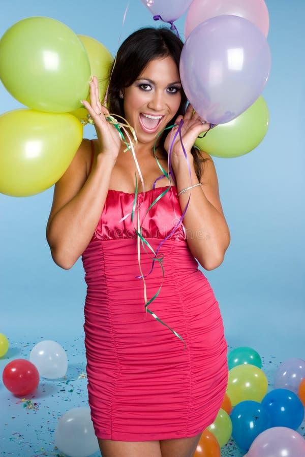 Balões da terra arrendada da menina fotos de stock royalty free