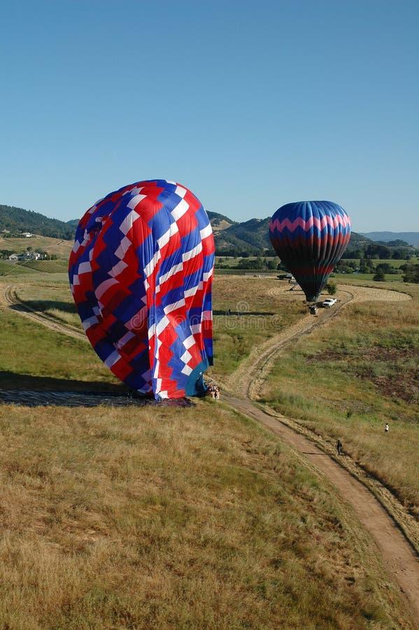 Balões de ar quente de aterragem imagens de stock royalty free