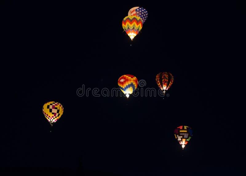 Balões de ar quente de incandescência fotos de stock