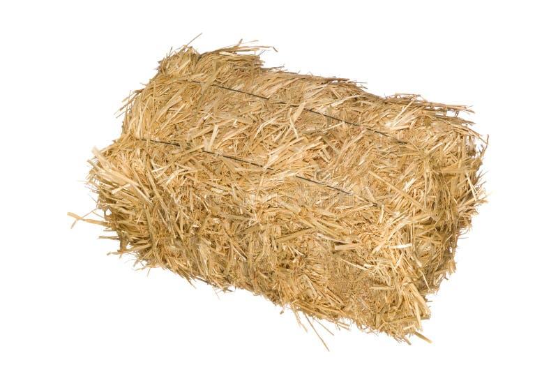 Bala de heno aislada en blanco foto de archivo