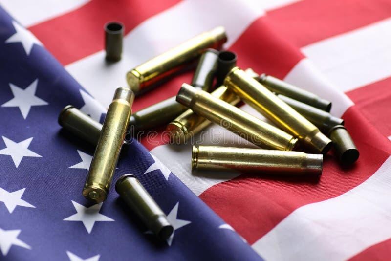 Bala na bandeira dos EUA imagens de stock