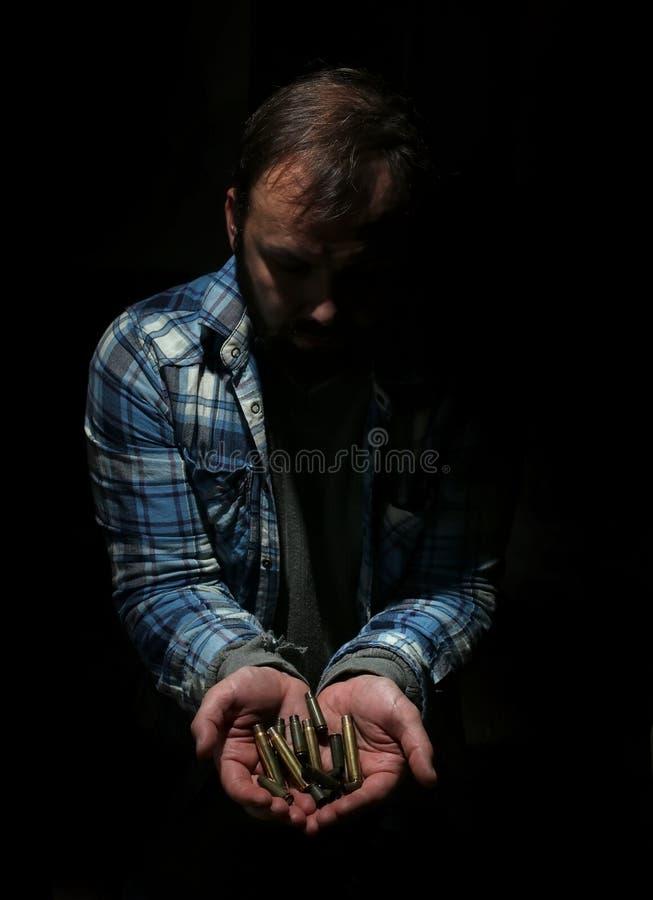 Bala no homem das mãos fotografia de stock royalty free