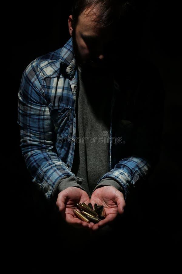 Bala no homem das mãos fotos de stock royalty free